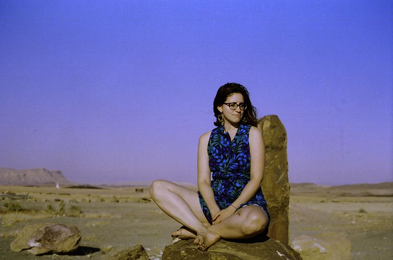 Young woman on a rock in the desert