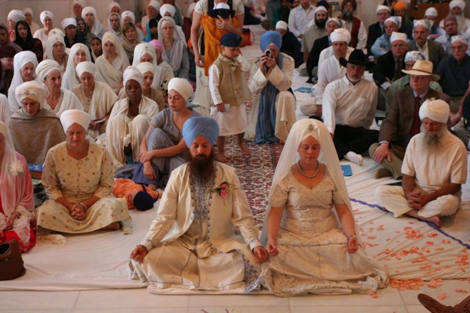 Couple Sitting Side by Side in Sikh Wedding Ceremony