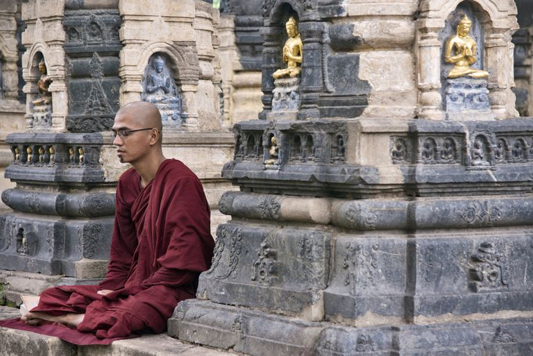 A monk meditates at Mahabodhi Temple, Bodh Gaya, India, the site of the Buddha's enlightenment.