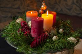 High Angle View Of Candles With Pine Cones And Wreath On Table