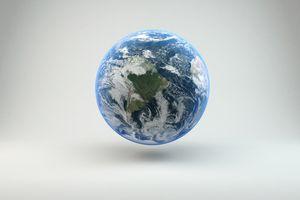 Close-Up Of Globe Against White Background