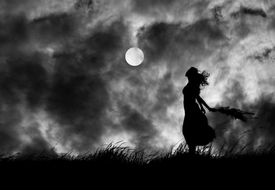 Woman Holding Plant While Standing On Field Against Moon In Sky