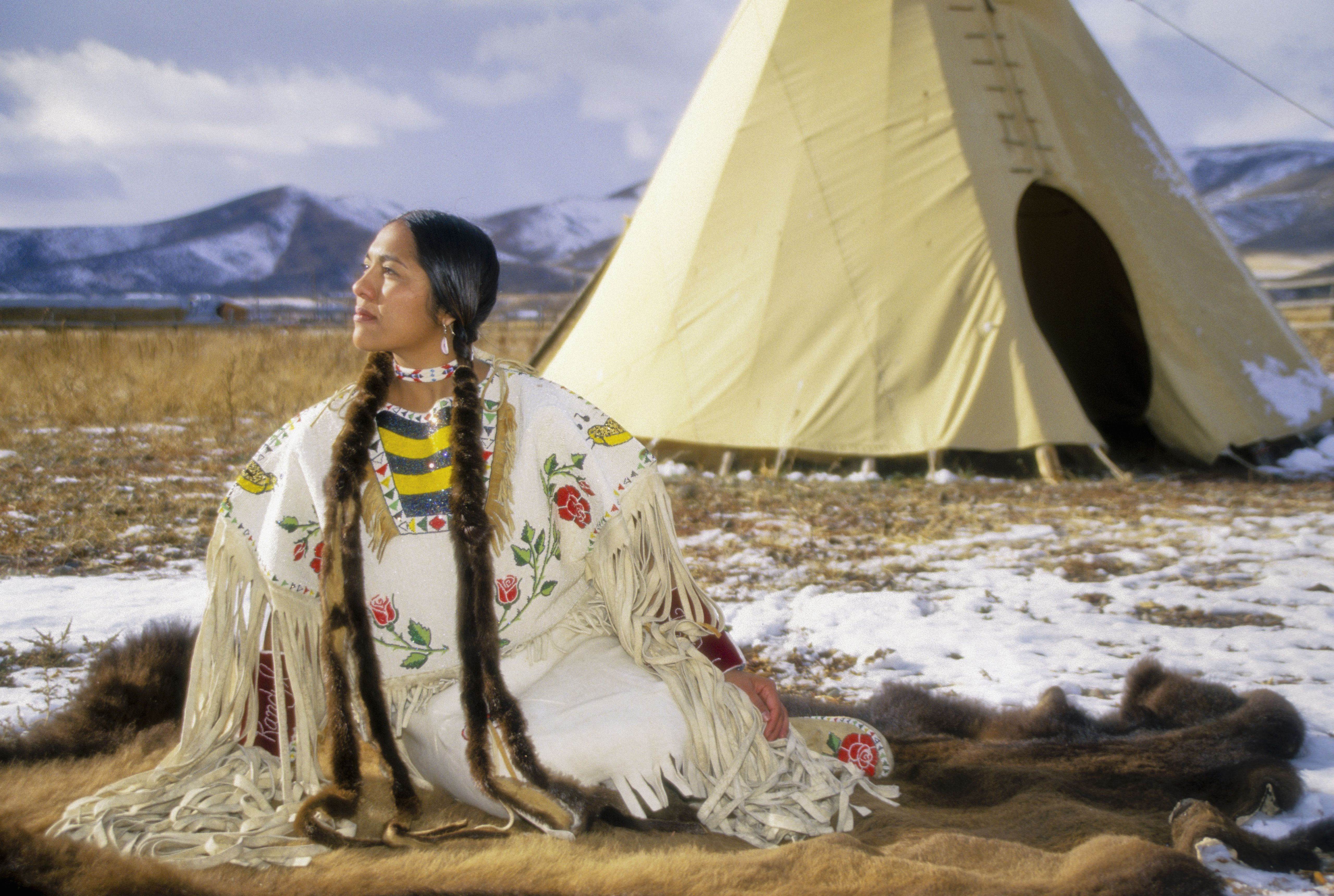 Shoshone-Cree woman dressed in beaded brain tanned clothing