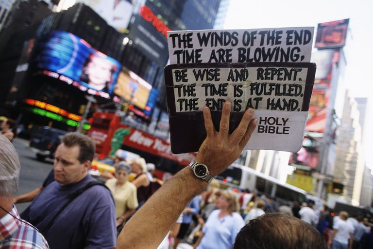 Street Preacher Holding Sign.