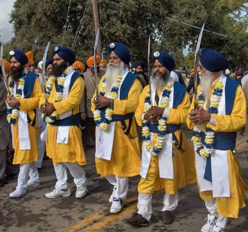 Panj Payra Holding Swords in Yuba City Annual Sikh Parade