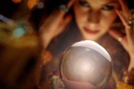 Fortune teller looking into crystal ball, close-up