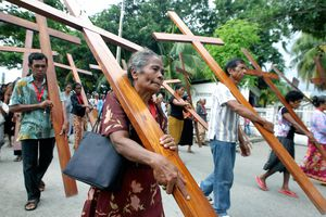 East Timorese Christians carry crucifixe