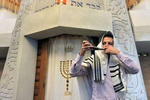 Jewish Rabbi Blows Shofar in a Synagogue