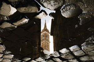 Reflection of the church in puddle, Rome, Italy