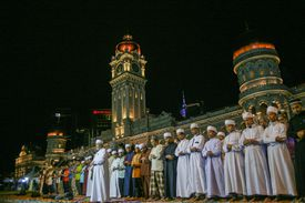 Muslim men outside large building