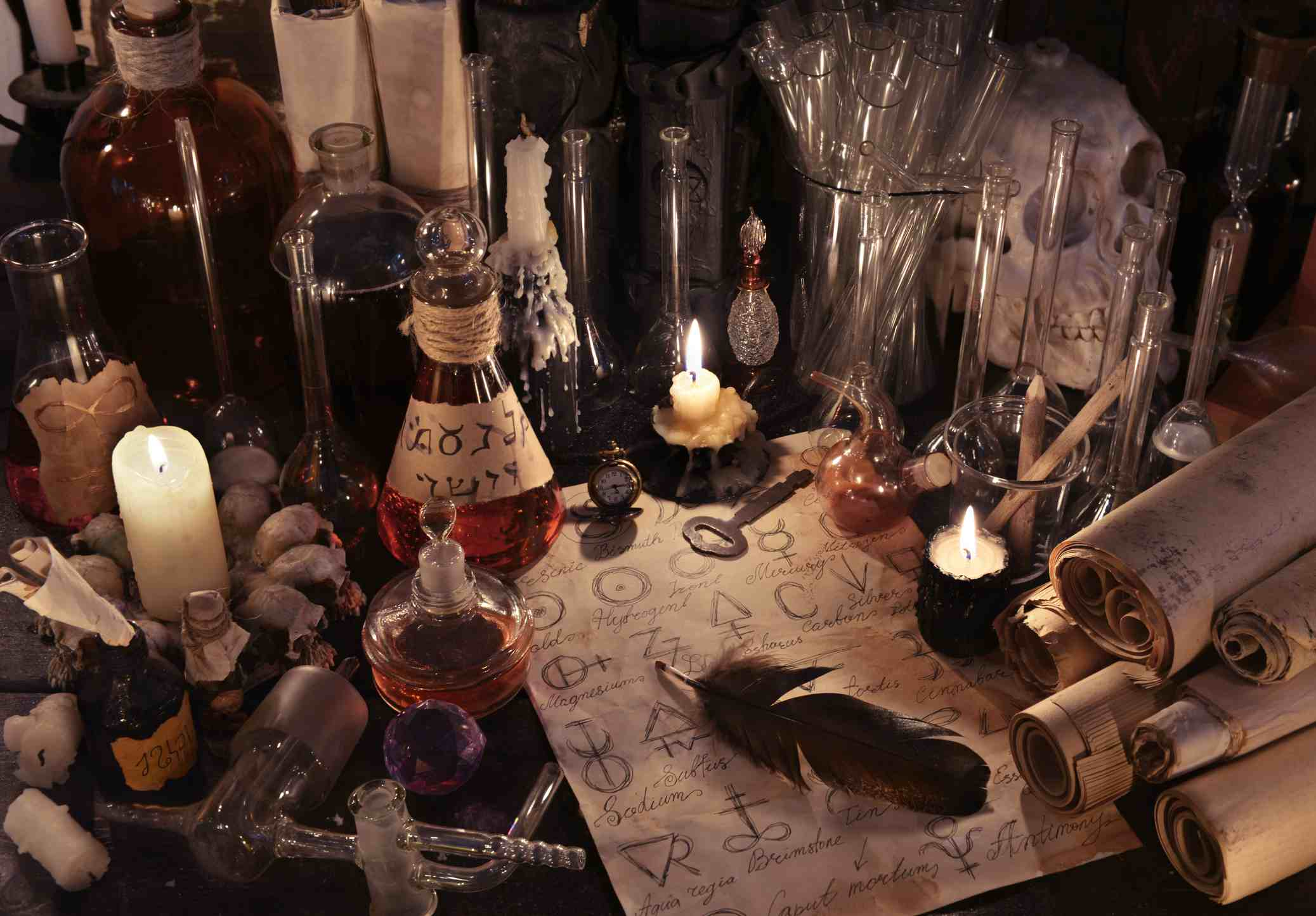 Mystic still life with alchemy paper, bottles and candles