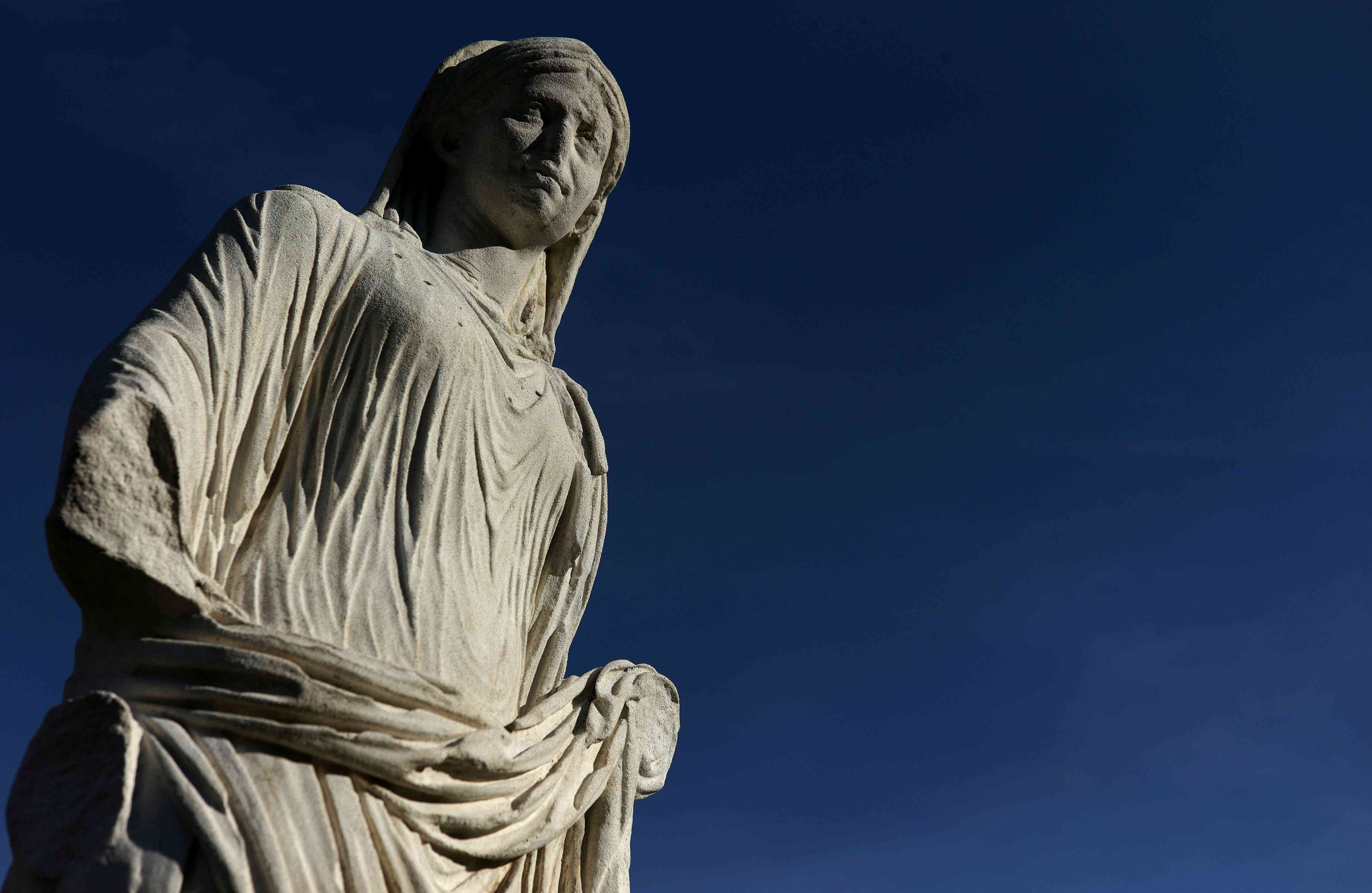 A statue of a Vestal is displayed at the