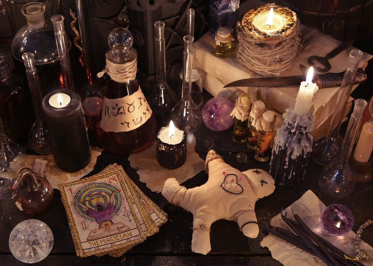 Still life with voodoo doll, tarot cards and magic objects