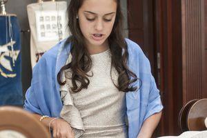 Caucasian teenage girl reading Torah at bat mitzvah