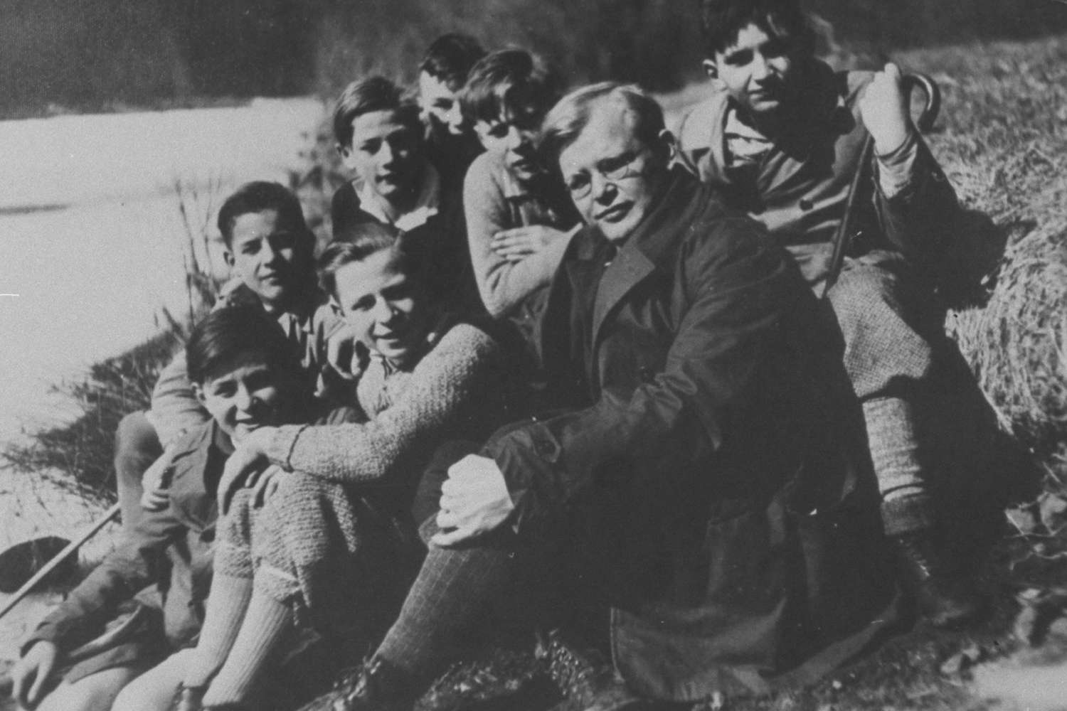 Young Dietrich Bonhoeffer with workers' sons on an outing near Berlin.