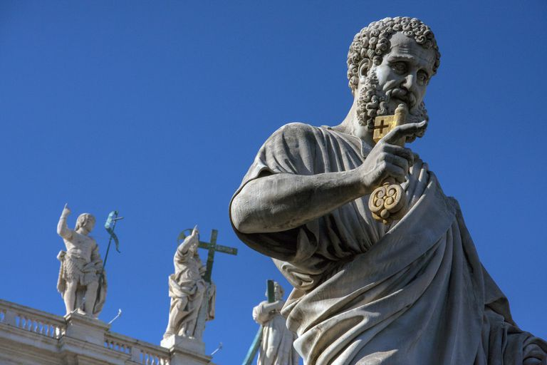Statue of Saint Peter against blue sky