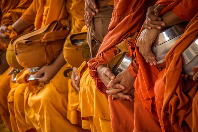 Monk in Orange Robes With Alms Bowl