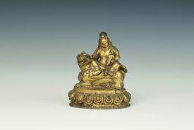 Gilt-copper figure of Kubera, Tibet, 18th century.