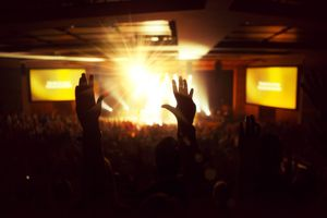 Hands up with bright light at a worship concert