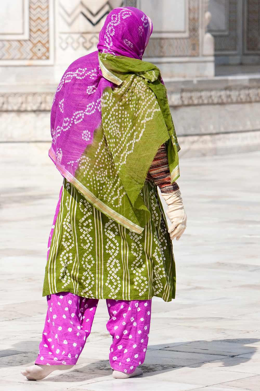 A woman wearing a colorful shalwar kameez