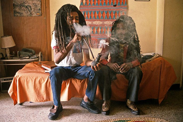 Two men smoking ganja