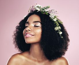 African woman with natural hair and wildflower crown
