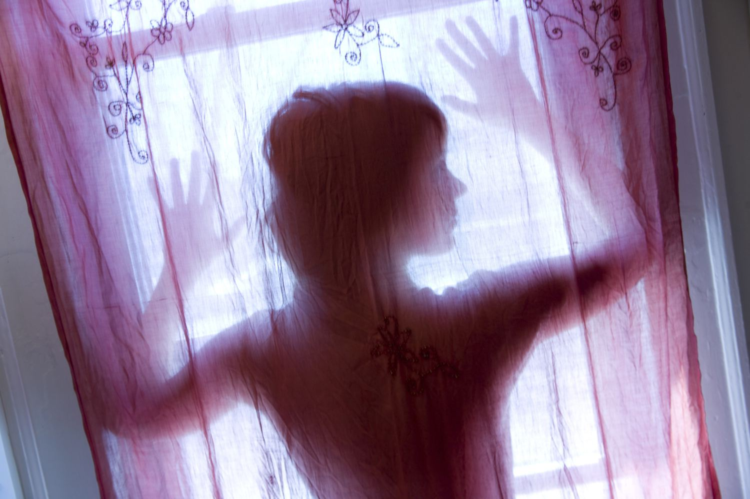 Ghostly woman in window