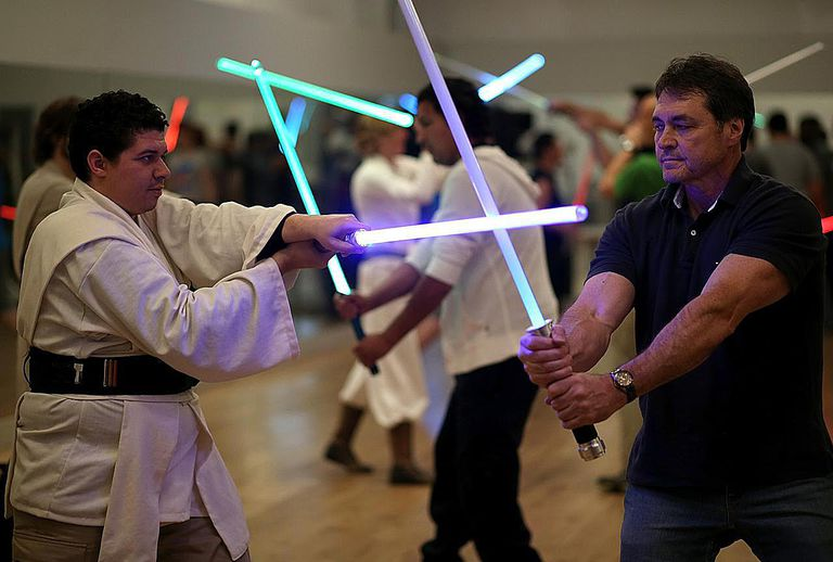 Star Wars fans train in a light-saber class